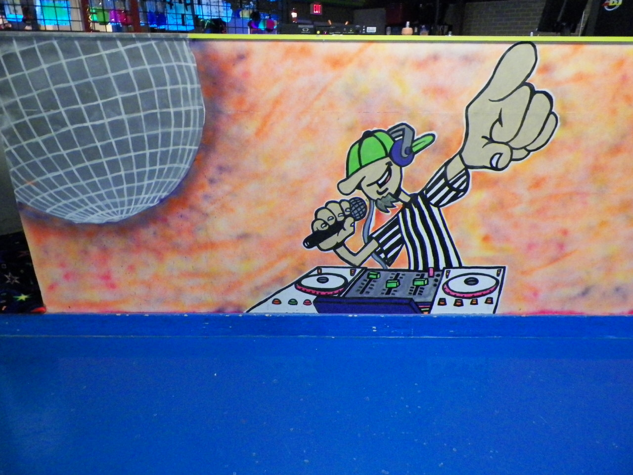 DJ booth artwork at turn 1